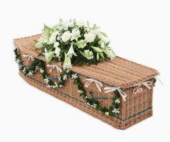 Traditional shape coffin in buff willow and inlaid with green bands and handles