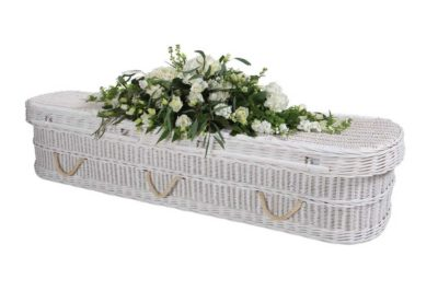 White wicker rounded coffin